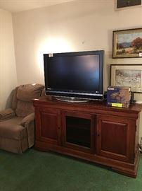 Media center, recliner, flat screen tv , Sony handycam, philips vcr DVD player