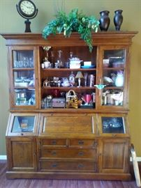 """This Stunning  2/pc cabinet is in the very large living room just beyond the foyer.  6'6"""" wide X 8' tall. Featuring 9 shelves above with 2 glass side doors on top + the bottom has 2 slant-top doors, 1 drop-down desktop, 2 doors nestled against a chest of drawers.  Gorgeous!  Beautiful accent to house your pretties!"""