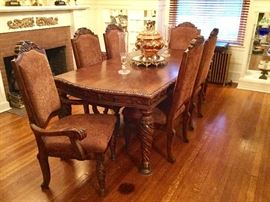 Dark wood carved Dining Table (44w x 68l x30 h without leaf, 44w x 86l x 30h with leaf); Dark wood dining room chairs with fabric seat cushion (2 captain chairs, 4 side chairs 22w x 20d x 47h);