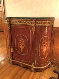 Antique wood inlaid crescent-shaped cabinet with marbled top and gold accents (60w x 20d x 58h)