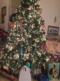 Lots of presents under the 6' tree.  Buy the tree fully decorated in vintage ornaments.  The bottom 1/2 comes with it for a 12'  beauty!