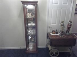 Lighted curio has Lladros and other pieces