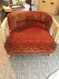 There are 2 of these vintage chairs that are exactly alike.