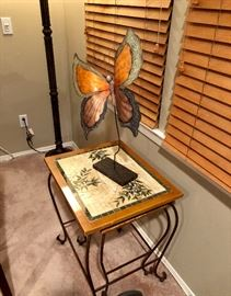 Butterfly sculpture and mosaic nesting tables
