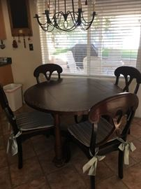 Kitchen table w/ reversible game table and drop leaf sides