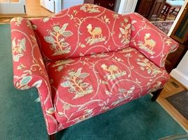 Chippendale upholstered love seat.  1 of 2