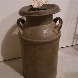 Vintage milk can, with delivery tag still attached.