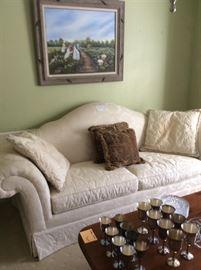 Beautiful cream colored camel back sofa