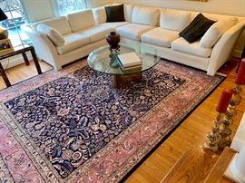 Tabriz rug and sectional white sofa