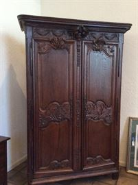 Stunning carved wood armoire