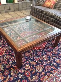 More rugs and glass top coffee table