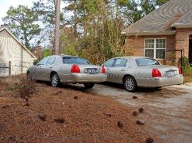 His and Her Lincoln Town Cars. Heated leather seats perfect for a toasty drive through the sparkling winter wonderland.
