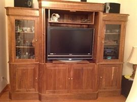 This is a beautiful Handmade entertainment center,made by the owner of the house out of wood he brought down from his tree farm up north...it is absolutely gorgeous