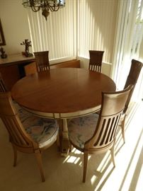 Fabulous 1970's retro round dining room table, 6 chairs, and 2 leaves