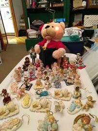 Baby Ornaments that are replicas of porcelain dolls and a Teddy Santa Reading the Night Before Christmas