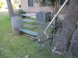 Antique galvanized oil barrels - tomato cages, buck board seat, and more.