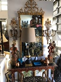 Palladio gilded iron mirror, over faux tortoise painted console.