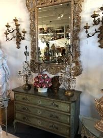 19th century painted commode, shown with silvergilt foliate-carved mirror.