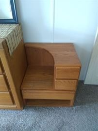 Pair of attached teak end tables  $100