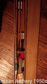 Antique and modern archery equipment.