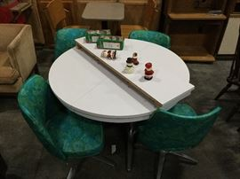 Retro dining room set with turquoise chairs