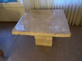We have three Italian rough-cut travertine tables. 1 console, 1 coffee table, & 1 side table (pictured).