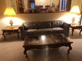 Vintage oak tables, alabaster table lamps, and floral 7' couch.