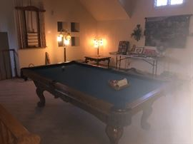 All accessories are included with the purchase of this fine pool table.