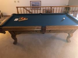 Oldhausen 8' oak pool table. Everything about this table is very nice. Bumpers and felt are immaculate! The hand carved ball & claw legs and scratch free rails could make this table a beautiful addition to your den.