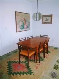 MCM table w/hide-away leaf and 6 chairs, 8' x 11' vintage handwoven Dhurrie rug, large Native American Pottery painting by NIKOL, framed Native American tapestry