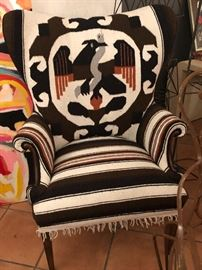 This custom chair reupholstered in a Peruvian textile. Complete with fringe, mid century legs.