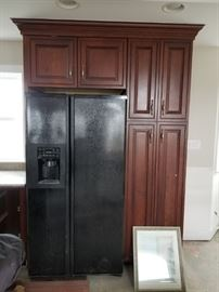 Refrigerator not included; detail to show cabinet configuration