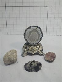 Mounted geode with assorted minerals and rocks