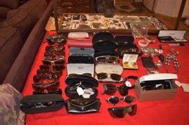 Mens and womans designer sunglasses, Cartier, Gucci, Versace, Ray Ban, Oakley, Bolle, Dolce & Gabana, Hugo Boss, and Movado Watch in the box.