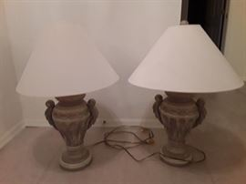 2 beige urn style lamps