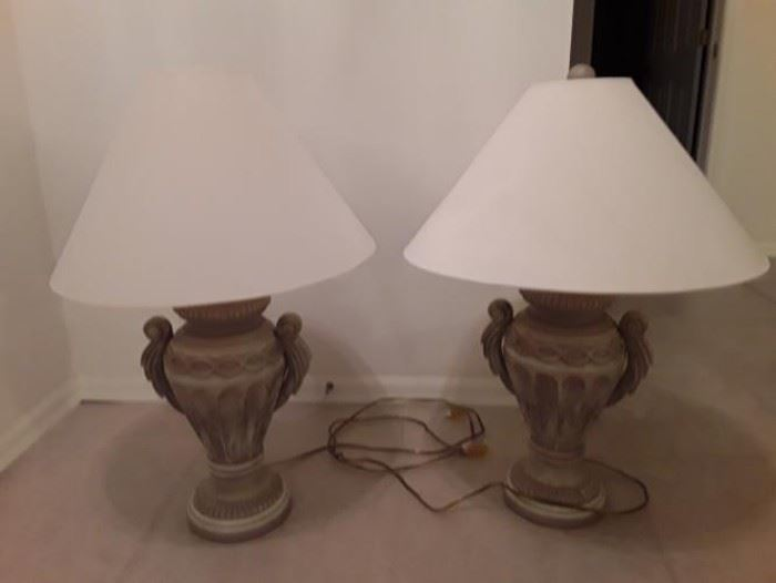 2 beige urn style lamps
