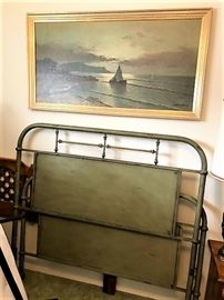 metal bed and painting
