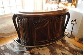 """Michael Amini """"Oppulente Collection Bar, Marble Top Bar Surface in """"Sienna Spice"""" Curved Shape, Solid Wood, Inlaid Wood Pattern, Carved Rosettes, Antique Brass Curved Foot Rail. 42 1/4 H x 72"""" W x 30"""" D. Wider @ Base & Foot Rail. $1140.00"""