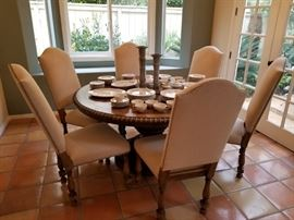 Wood, pedestal dining table with 6 upholstered chairs