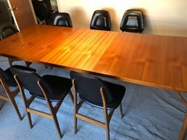 Table (W/ extra middle leaf pulled up from below) with 8 Brodrene Solheim Chairs