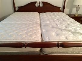 King 4-poster Bed, 2 Twin Restonic Mattress/Spring. Double Pillowtop on the right.