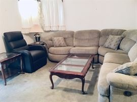 Brown bonded leather LIFT recliner.  Sectional has a WALL HUGGER recliner on one end and a swivel round chair on the other end.