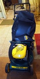 """Yard-Man Gas Powered, Self Propelled Walk Behind Mower With 21"""" Deck, Electric Start And Bagging Attachments Model # 126E849E401"""