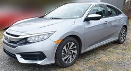 2018 Honda Civic EX Sedan | 1,730 Miles; Silver Exterior, Black Sport Cloth Interior; 2.0L i-VTEC 4-Cylinder Engine; 4-Wheel Antilock Disc Brakes; Power Moonroof; Audio System with  8 Speakers, Center Display Screen, HD Radio, USB Audio Interface, Sirius XM Satellite Radio (with subscription); Multi-view Rear Camera; Bluetooth Hands-free Link; Push Button Start; Automatic Climate Control System; Car Play/Android Auto Integration; Power Windows, Doors, Mirrors; 16-in. Alloy Wheels; Remote Keyless Entry, and more. VIN: 2HGFC2F7XJH568823. Vehicle Terms:  Vehicles are sold AS IS, in AS FOUND/ESTATE condition; Minimum of 10% deposit due on day of auction. May be paid with Cash, Check, VISA, MC, Debit; Balance paid in full by Thursday following. Must be paid with Cash or Certified Bank Check ONLY.