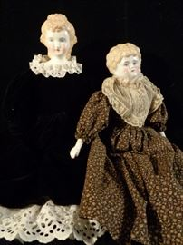 Two antique porcelain head dolls