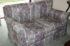 Floral love seat.