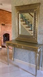 Vintage silver gilt French Regency style console and ornate mirror.