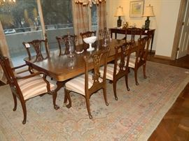 Double pedestal table with inlaid design.  TWELVE claw and ball Chippendale chairs.