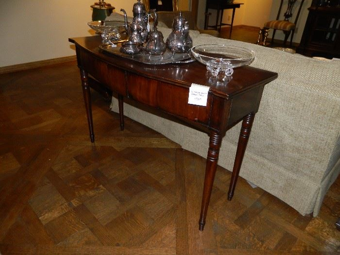 Antique mahogany console.  Silver plated tea service.  Pair of STEUBEN bowls.