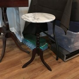 #5 marble top round pedistal table 12x22  $35.00